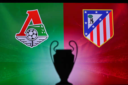 NYON, SWISS, NOVEMBER 2. 2020: Lokomotiv Moscow vs. Atlético Madrid. Football UEFA Champions League 2021 Group Stage match. UCL Trophy silhouette, sign of club on the screen in background