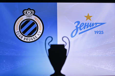 NYON, SWISS, NOVEMBER 2. 2020: Club Brugge vs. Zenit Saint Petersburg. Football UEFA Champions League 2021 Group Stage match. UCL Trophy silhouette, sign of club on the screen in background