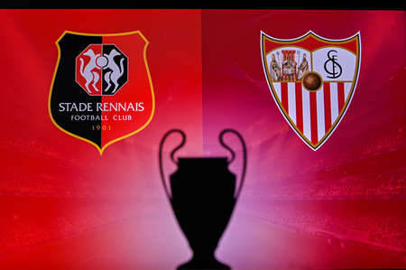 NYON, SWISS, NOVEMBER 2. 2020: Stade Rennes Vs. Seville. Football UEFA Champions League 2021 Group Stage match. UCL Trophy silhouette, sign of club on the screen in background