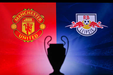 NYON, SWISS, NOVEMBER 2. 2020: Manchester United vs. RB Leipzig. Football UEFA Champions League 2021 Group Stage match. UCL Trophy silhouette, sign of club on the screen in background 新聞圖片