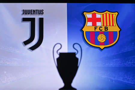 NYON, SWISS, NOVEMBER 2. 2020: Juventus Vs. FC Barcelona. Football UEFA Champions League 2021 Group Stage match. UCL Trophy silhouette, sign of club on the screen in background