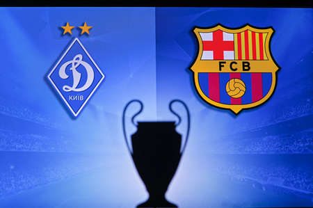 NYON, SWISS, NOVEMBER 2. 2020: Dynamo Kyiv Vs. FC Barcelona. Football UEFA Champions League 2021 Group Stage match. UCL Trophy silhouette, sign of club on the screen in background 新聞圖片