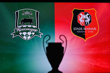 NYON, SWISS, NOVEMBER 2. 2020: Krasnodar Vs. Stade Rennes. Football UEFA Champions League 2021 Group Stage match. UCL Trophy silhouette, sign of club on the screen in background 新聞圖片