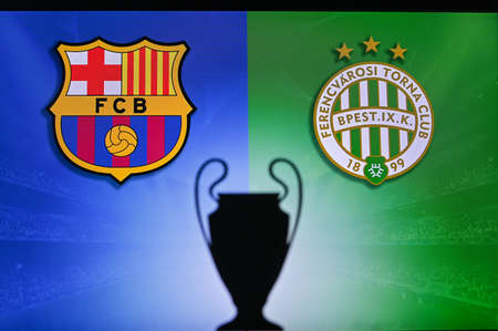 NYON, SWISS, NOVEMBER 2. 2020: Barcelona Vs. Ferencváros Budapest. Football UEFA Champions League 2021 Group Stage match. UCL Trophy silhouette, sign of club on the screen in background