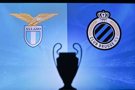 NYON, SWISS, NOVEMBER 2. 2020: Lazio Vs. Club Brugge. Football UEFA Champions League 2021 Group Stage match. UCL Trophy silhouette, sign of club on the screen in background