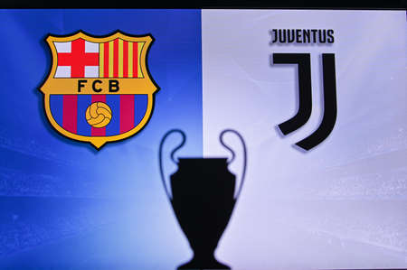 NYON, SWISS, NOVEMBER 2. 2020: Barcelona Vs. Juventus. Football UEFA Champions League 2021 Group Stage match. UCL Trophy silhouette, sign of club on the screen in background