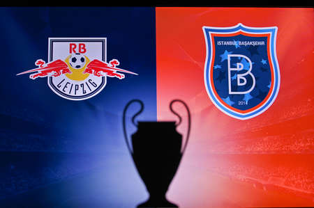 NYON, SWISS, NOVEMBER 2. 2020: RB Leipzig Vs. Ä°stanbul Basaksehir. Football UEFA Champions League 2021 Group Stage match. UCL Trophy silhouette, sign of club on the screen in background