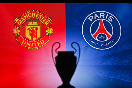 NYON, SWISS, NOVEMBER 2. 2020: Manchester United vs. Paris Saint-Germain. Football UEFA Champions League 2021 Group Stage match. UCL Trophy silhouette, sign of club on the screen in background