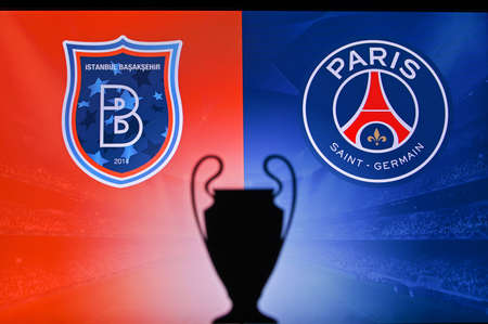 NYON, SWISS, NOVEMBER 2. 2020: Istanbul Basaksehir Vs. Paris Saint-Germain. Football UEFA Champions League 2021 Group Stage match. UCL Trophy silhouette, sign of club on the screen in background 新聞圖片