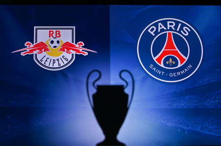 NYON, SWISS, NOVEMBER 2. 2020: RB Leipzig Vs. Paris Saint-Germain. Football UEFA Champions League 2021 Group Stage match. UCL Trophy silhouette, sign of club on the screen in background
