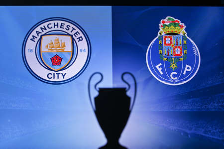 NYON, SWISS, NOVEMBER 2. 2020: Manchester City Vs. Porto FC. Football UEFA Champions League 2021 Group Stage match. UCL Trophy silhouette, sign of club on the screen in background