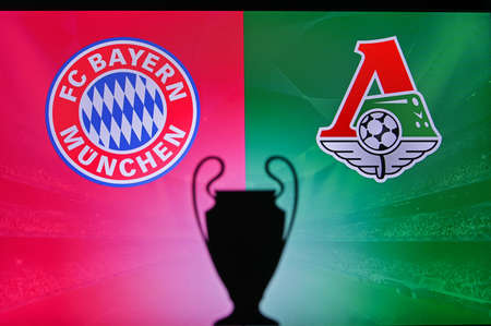 NYON, SWISS, NOVEMBER 2. 2020: Bayern Munich vs. Lokomotiv Moscow. Football UEFA Champions League 2021 Group Stage match. UCL Trophy silhouette, sign of club on the screen in background