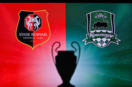 NYON, SWISS, NOVEMBER 2. 2020: Stade Rennes Vs. Krasnodar. Football UEFA Champions League 2021 Group Stage match. UCL Trophy silhouette, sign of club on the screen in background