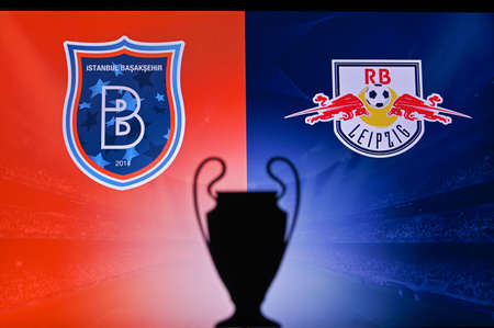 NYON, SWISS, NOVEMBER 2. 2020: Istanbul Basaksehir Vs. RB Leipzig. Football UEFA Champions League 2021 Group Stage match. UCL Trophy silhouette, sign of club on the screen in background 新聞圖片