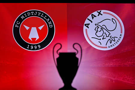 NYON, SWISS, NOVEMBER 2. 2020: Midtjylland Vs. Ajax Amsterdam. Football UEFA Champions League 2021 Group Stage match. UCL Trophy silhouette, sign of club on the screen in background