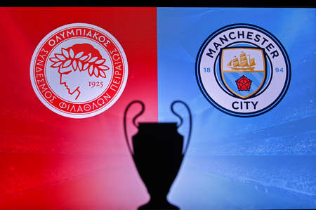 NYON, SWISS, NOVEMBER 2. 2020: Olympiacos Piraeus Vs. Manchester City. Football UEFA Champions League 2021 Group Stage match. UCL Trophy silhouette, sign of club on the screen in background