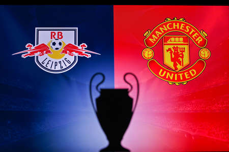 NYON, SWISS, NOVEMBER 2. 2020: RB Leipzig Vs. Manchester United. Football UEFA Champions League 2021 Group Stage match. UCL Trophy silhouette, sign of club on the screen in background