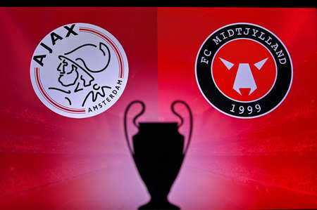 NYON, SWISS, NOVEMBER 2. 2020: Ajax Amsterdam vs. Central Jutland. Football UEFA Champions League 2021 Group Stage match. UCL Trophy silhouette, sign of club on the screen in background