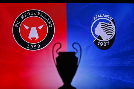 NYON, SWISS, NOVEMBER 2. 2020: Midtjylland Vs. Atalanta. Football UEFA Champions League 2021 Group Stage match. UCL Trophy silhouette, sign of club on the screen in background