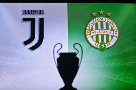 NYON, SWISS, NOVEMBER 2. 2020: Juventus Vs. Ferencváros Budapest. Football UEFA Champions League 2021 Group Stage match. UCL Trophy silhouette, sign of club on the screen in background