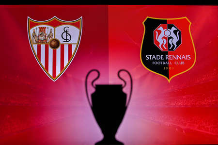 NYON, SWISS, NOVEMBER 2. 2020: Sevilla vs. Stade Rennes. Football UEFA Champions League 2021 Group Stage match. UCL Trophy silhouette, sign of club on the screen in background 新聞圖片