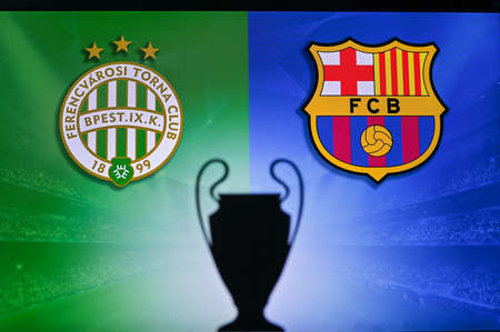 NYON, SWISS, NOVEMBER 2. 2020: Ferencváros Budapest vs. FC Barcelona. Football UEFA Champions League 2021 Group Stage match. UCL Trophy silhouette, sign of club on the screen in background