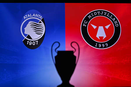 NYON, SWISS, NOVEMBER 2. 2020: Atalanta Vs. Central Jutland. Football UEFA Champions League 2021 Group Stage match. UCL Trophy silhouette, sign of club on the screen in background 新聞圖片