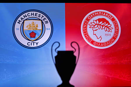NYON, SWISS, NOVEMBER 2. 2020: Manchester City Vs. Olympiacos Piraeus. Football UEFA Champions League 2021 Group Stage match. UCL Trophy silhouette, sign of club on the screen in background