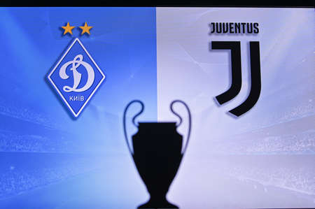 NYON, SWISS, NOVEMBER 2. 2020: Dynamo Kyiv Vs. Juventus. Football UEFA Champions League 2021 Group Stage match. UCL Trophy silhouette, sign of club on the screen in background