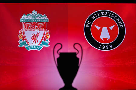 NYON, SWISS, NOVEMBER 2. 2020: Liverpool Vs. Central Jutland. Football UEFA Champions League 2021 Group Stage match. UCL Trophy silhouette, sign of club on the screen in background