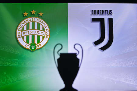 NYON, SWISS, NOVEMBER 2. 2020: Ferencváros Budapest vs. Juventus. Football UEFA Champions League 2021 Group Stage match. UCL Trophy silhouette, sign of club on the screen in background