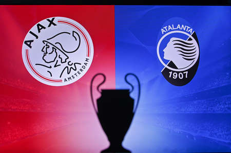 NYON, SWISS, NOVEMBER 2. 2020: Ajax Amsterdam vs. Atalanta. Football UEFA Champions League 2021 Group Stage match. UCL Trophy silhouette, sign of club on the screen in background