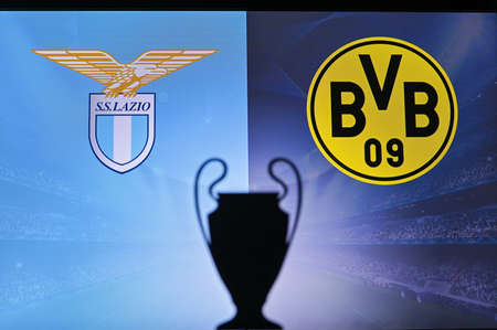 NYON, SWISS, NOVEMBER 2. 2020: Lazio Vs. Borussia Dortmund. Football UEFA Champions League 2021 Group Stage match. UCL Trophy silhouette, sign of club on the screen in background