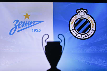 NYON, SWISS, NOVEMBER 2. 2020: Zenit Saint Petersburg vs. Club Brugge. Football UEFA Champions League 2021 Group Stage match. UCL Trophy silhouette, sign of club on the screen in background