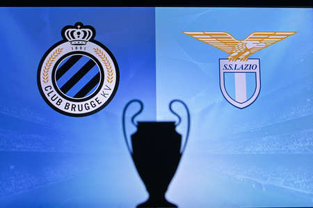 NYON, SWISS, NOVEMBER 2. 2020: Club Brugge vs. Lazio. Football UEFA Champions League 2021 Group Stage match. UCL Trophy silhouette, sign of club on the screen in background