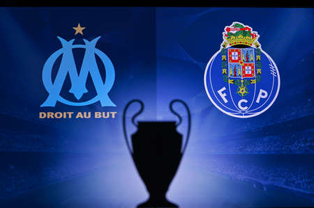 NYON, SWISS, NOVEMBER 2. 2020: Olympique Marseille vs. Porto FC. Football UEFA Champions League 2021 Group Stage match. UCL Trophy silhouette, sign of club on the screen in background