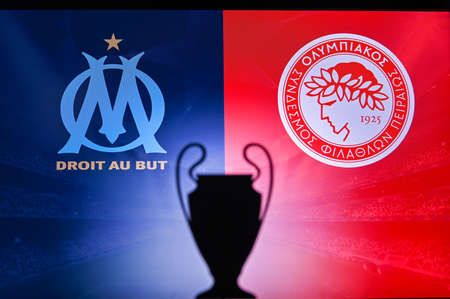 NYON, SWISS, NOVEMBER 2. 2020: Olympique Marseille vs. Olympiacos Piraeus. Football UEFA Champions League 2021 Group Stage match. UCL Trophy silhouette, sign of club on the screen in background