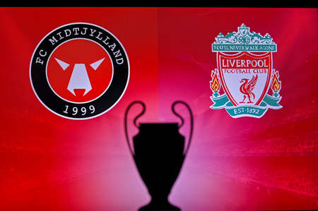 NYON, SWISS, NOVEMBER 2. 2020: Midtjylland Vs. Liverpool. Football UEFA Champions League 2021 Group Stage match. UCL Trophy silhouette, sign of club on the screen in background