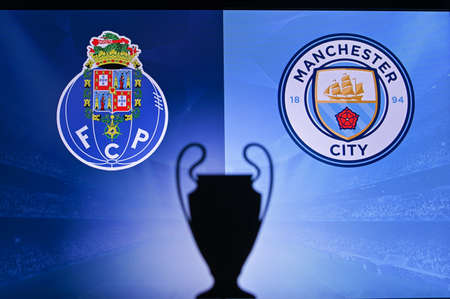 NYON, SWISS, NOVEMBER 2. 2020: Porto FC vs. Manchester City. Football UEFA Champions League 2021 Group Stage match. UCL Trophy silhouette, sign of club on the screen in background 新聞圖片