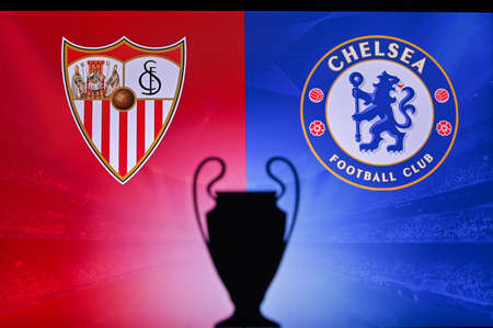 NYON, SWISS, NOVEMBER 2. 2020: Sevilla vs. Chelsea. Football UEFA Champions League 2021 Group Stage match. UCL Trophy silhouette, sign of club on the screen in background Redactioneel