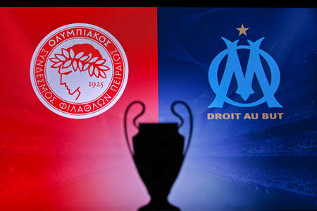 NYON, SWISS, NOVEMBER 2. 2020: Olympiacos Piraeus Vs. Olympique Marseille. Football UEFA Champions League 2021 Group Stage match. UCL Trophy silhouette, sign of club on the screen in background