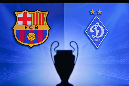 NYON, SWISS, NOVEMBER 2. 2020: Barcelona Vs. Dynamo Kyiv. Football UEFA Champions League 2021 Group Stage match. UCL Trophy silhouette, sign of club on the screen in background