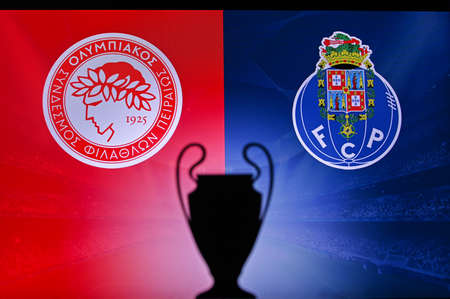 NYON, SWISS, NOVEMBER 2. 2020: Olympiacos Piraeus Vs. Porto FC. Football UEFA Champions League 2021 Group Stage match. UCL Trophy silhouette, sign of club on the screen in background