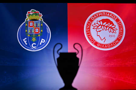 NYON, SWISS, NOVEMBER 2. 2020: Porto FC vs. Olympiacos Piraeus. Football UEFA Champions League 2021 Group Stage match. UCL Trophy silhouette, sign of club on the screen in background