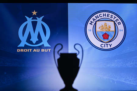 NYON, SWISS, NOVEMBER 2. 2020: Olympique Marseille vs. Manchester City. Football UEFA Champions League 2021 Group Stage match. UCL Trophy silhouette, sign of club on the screen in background