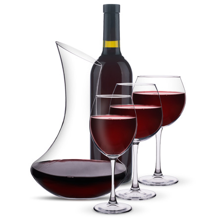 red wine with a decanter and a bottle on a white background