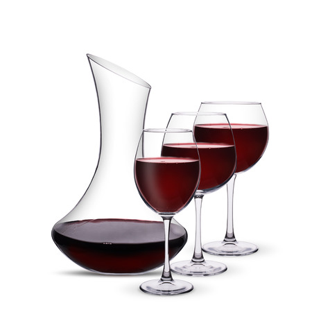 glasses with red wine and decanter on white background