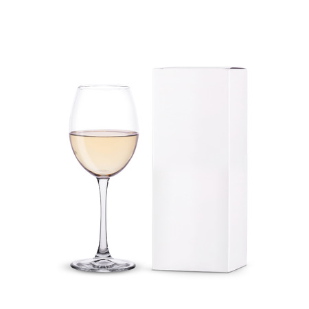 glass of wine with packing with place for text on white background. 免版税图像