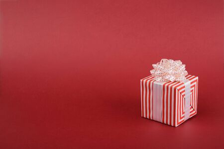 Gift box on red background. Banner background with space for text