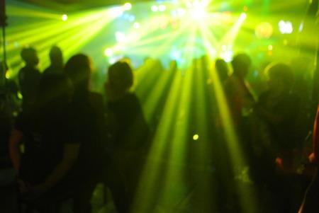 only three people: Defocused People Dancing In Nightclub